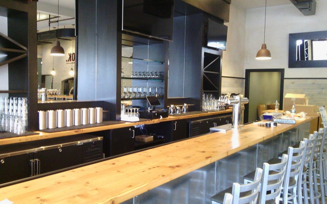 Custom-made reclaimed wood bar tops and tables